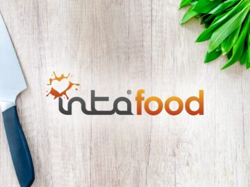 Intafood logo on wooden chopping block with knife